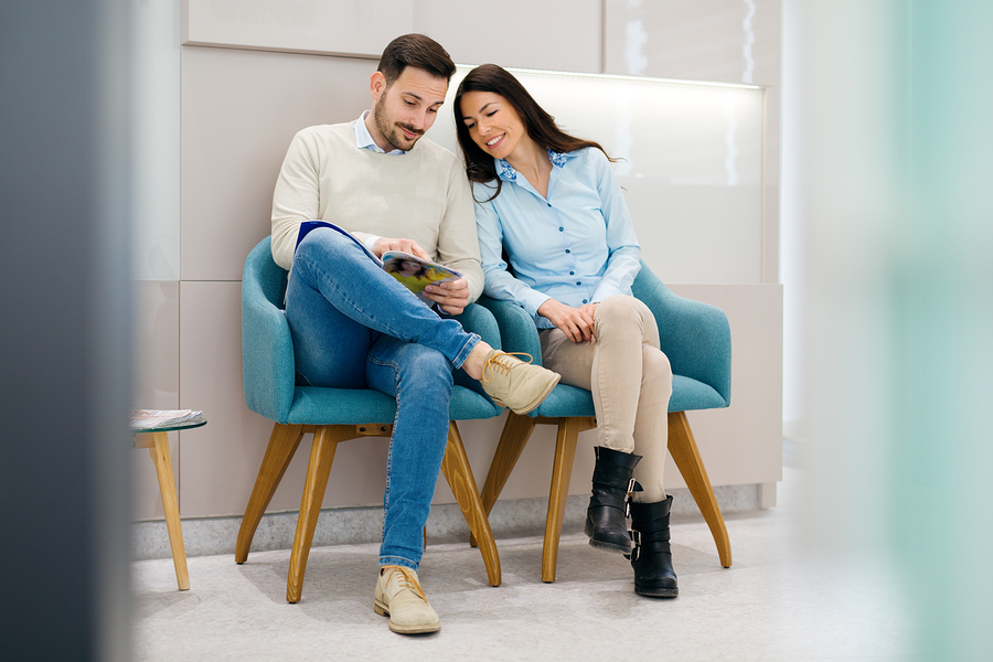 A couple waiting in a well designed dental office waiting room.