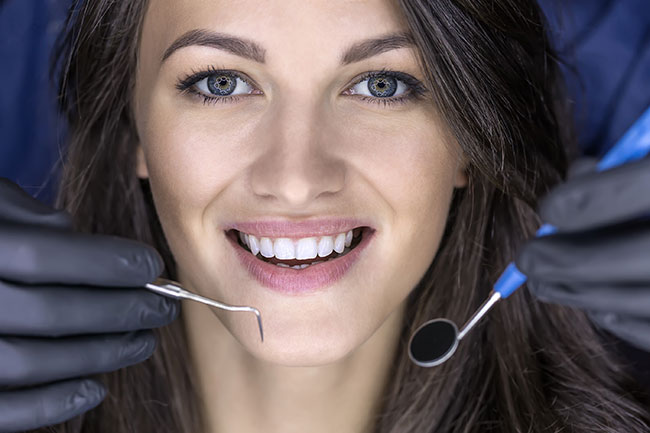woman getting dental work done is not worried