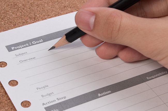 filling out a dental office design checklist