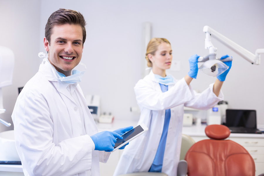 Happy dentist in a newly renovated treatment room.