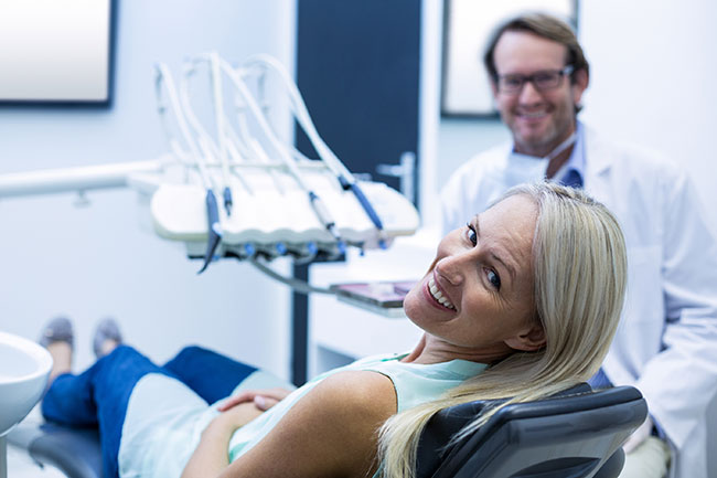 comfortable patient in dental office exam chair
