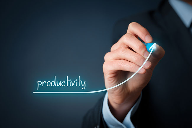 Hand drawing a line chart of increased productivity.