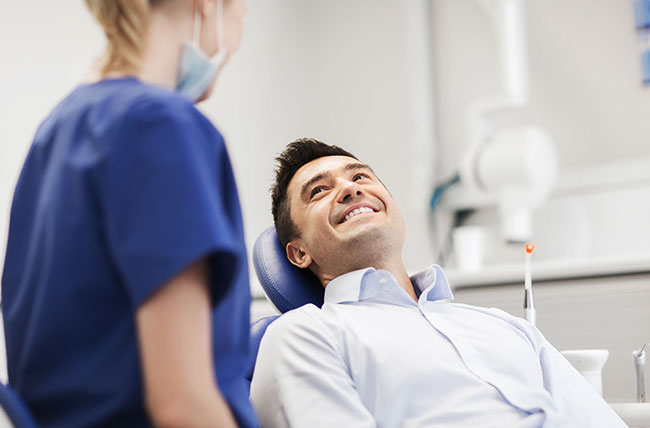 Positive Dental Patient Experience. Man having good dental experience